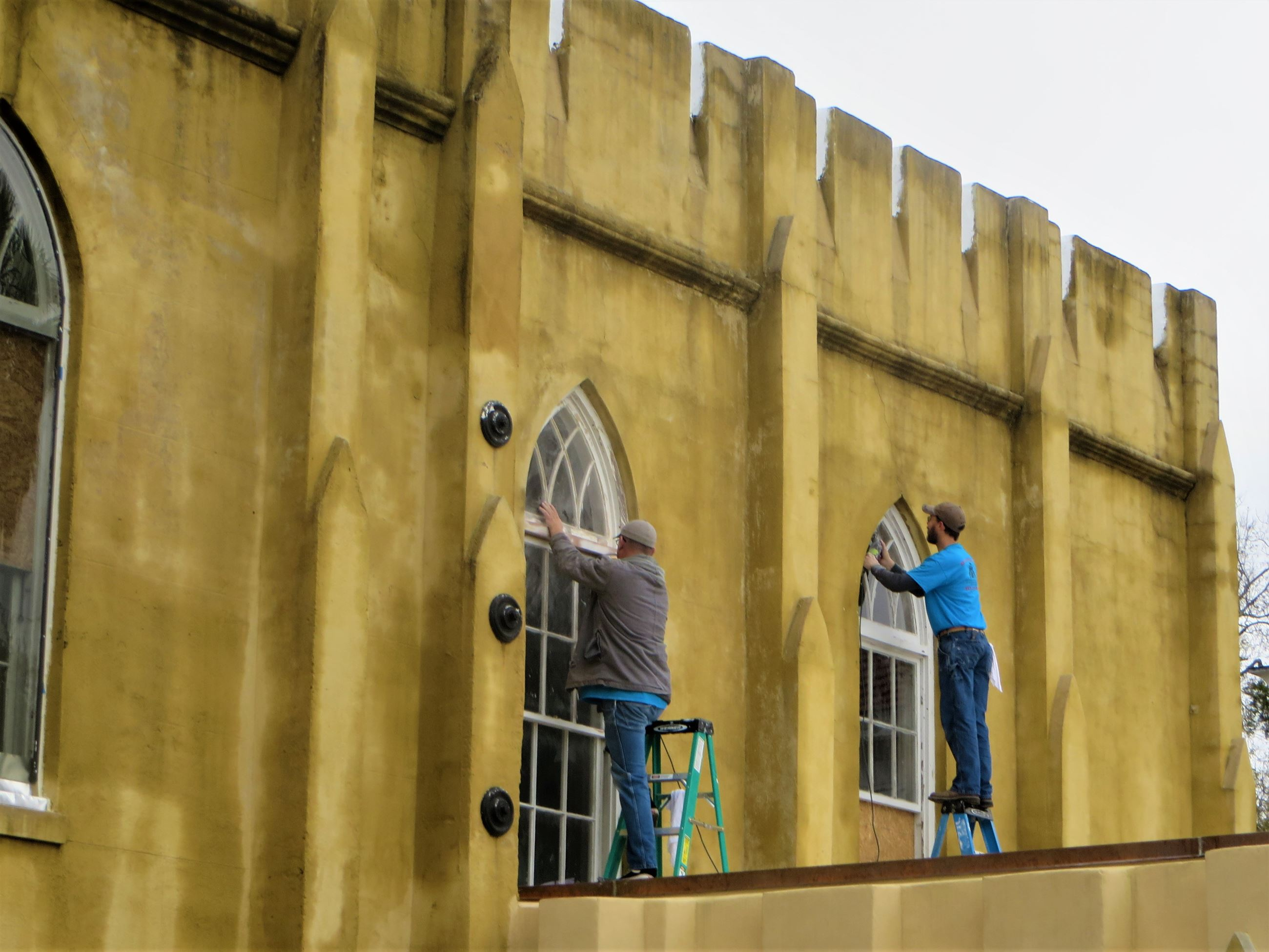 Workers restore windows at Arsenal in December 2019.
