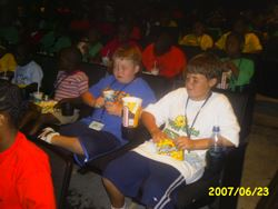 Children eating popcorn